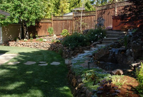 Lawn with Moss Rock Retaining Wall