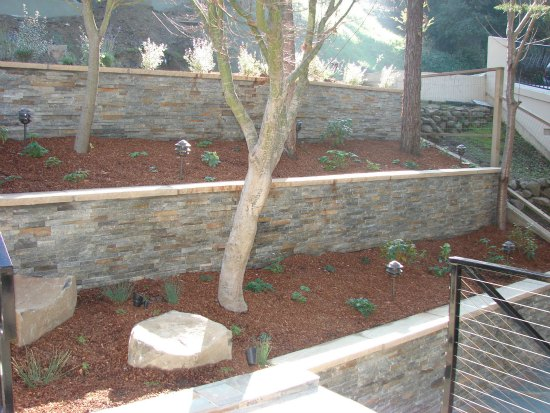 Retaining Wall with Ledge Stone Facade and Stone Wall Cap
