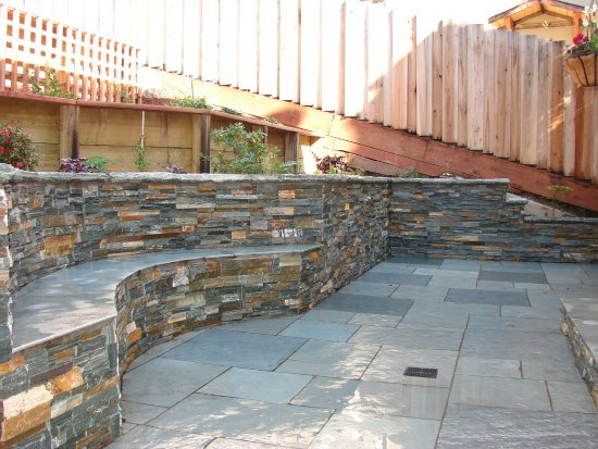 Stone Bench and Integrated Retaining Wall